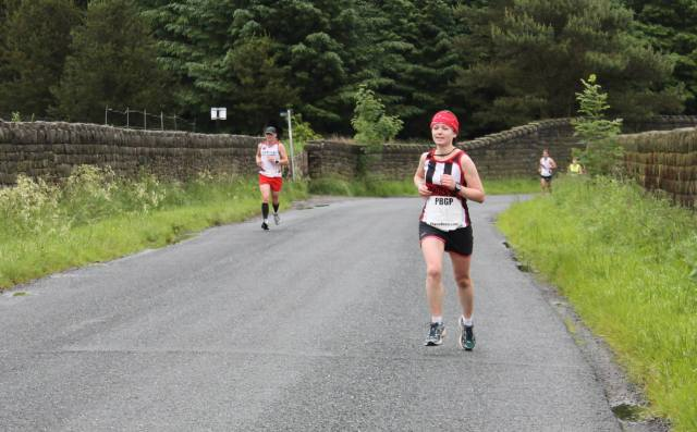 The first half of the race and still smiling, holding my head up. All was well at this point. (Photo credit: Richard Starkie)